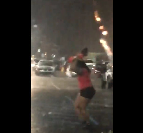 Mother Using Baby As An Umbrella