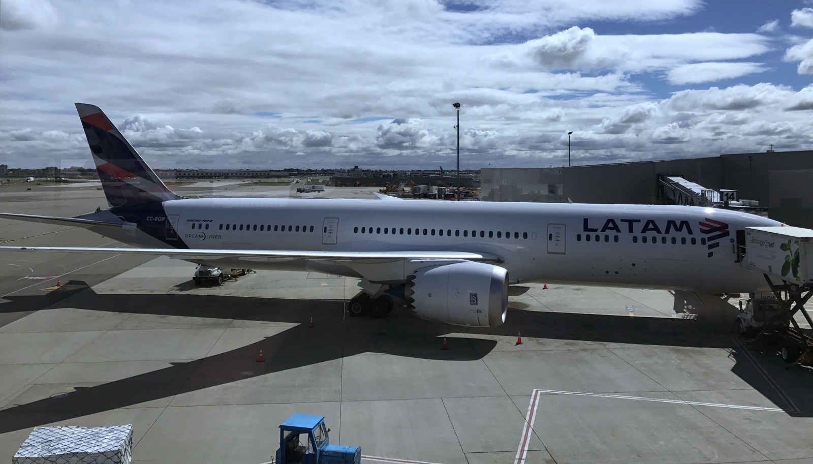 A Latam Airlines airliner sits at the gate at John F. Kennedy International Airport in New York