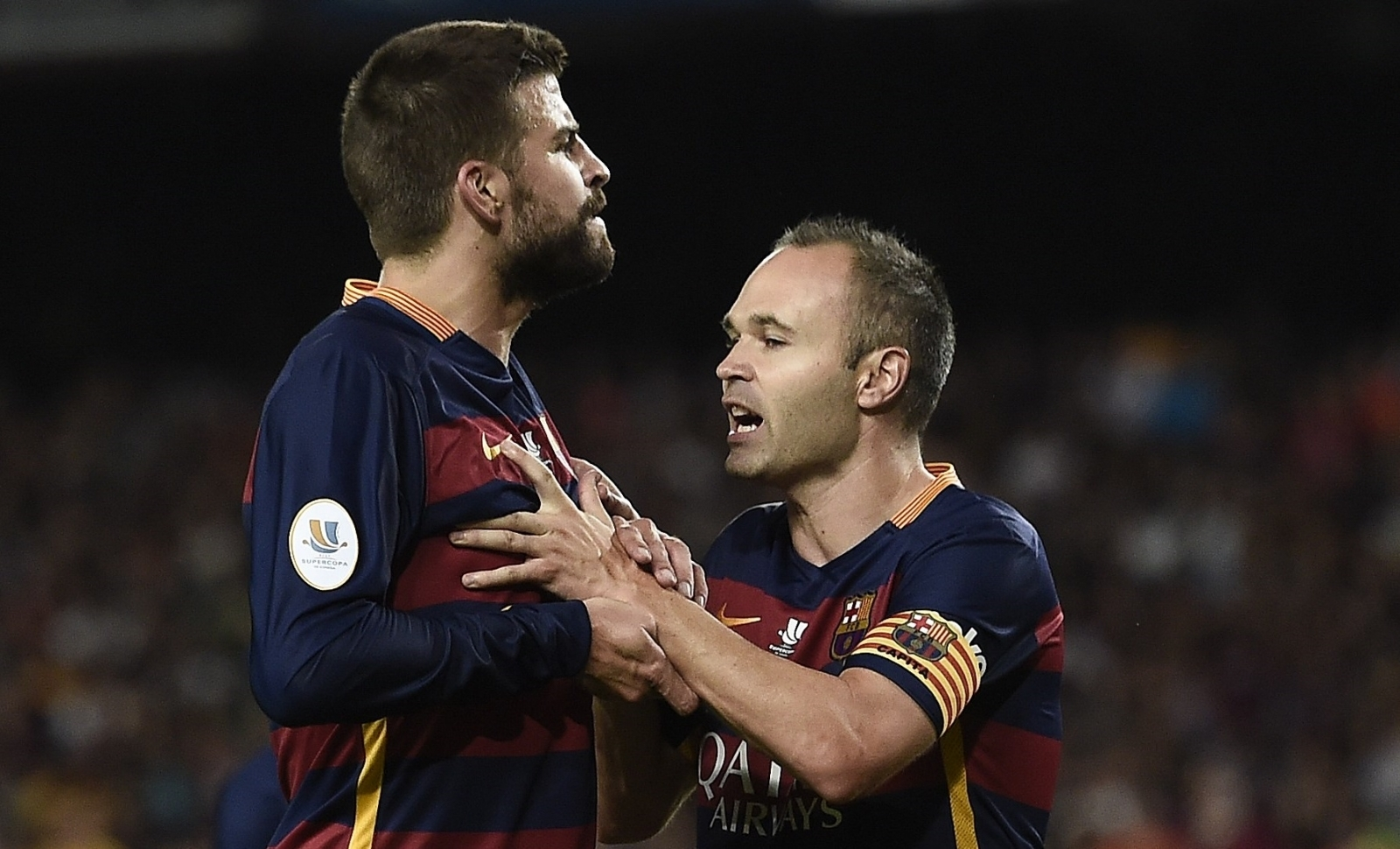 Gerard Pique and Andres Iniesta