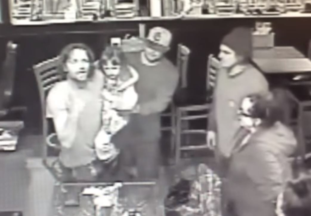 Man holds daughter during bar fight