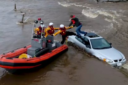 Dramatic Timelapse Shows Motorist Rescued From Car Roof In California Flood