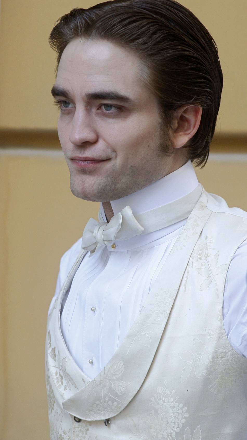 "British actor Robert Pattinson is seen during the filming of a scene in his new movie ""Bel Ami"" in Budapest April 8, 2010."