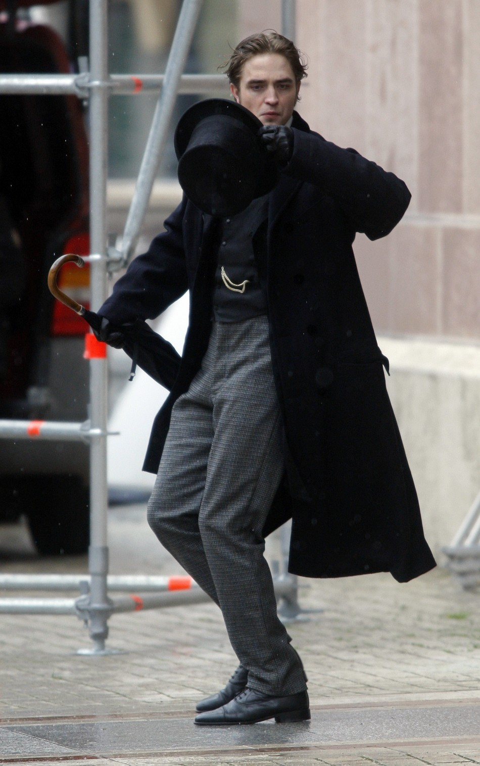 British actor Robert Pattinson is seen during the filming of a scene in his new movie, Bel Ami, in Budapest April 6, 2010.