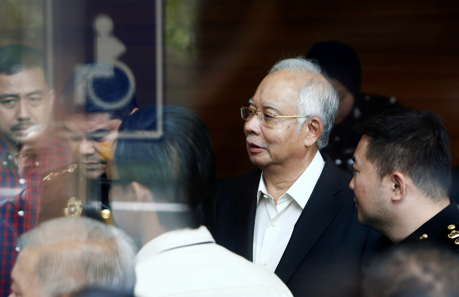 Malaysia's ex-leader questioned again in corruption scandal