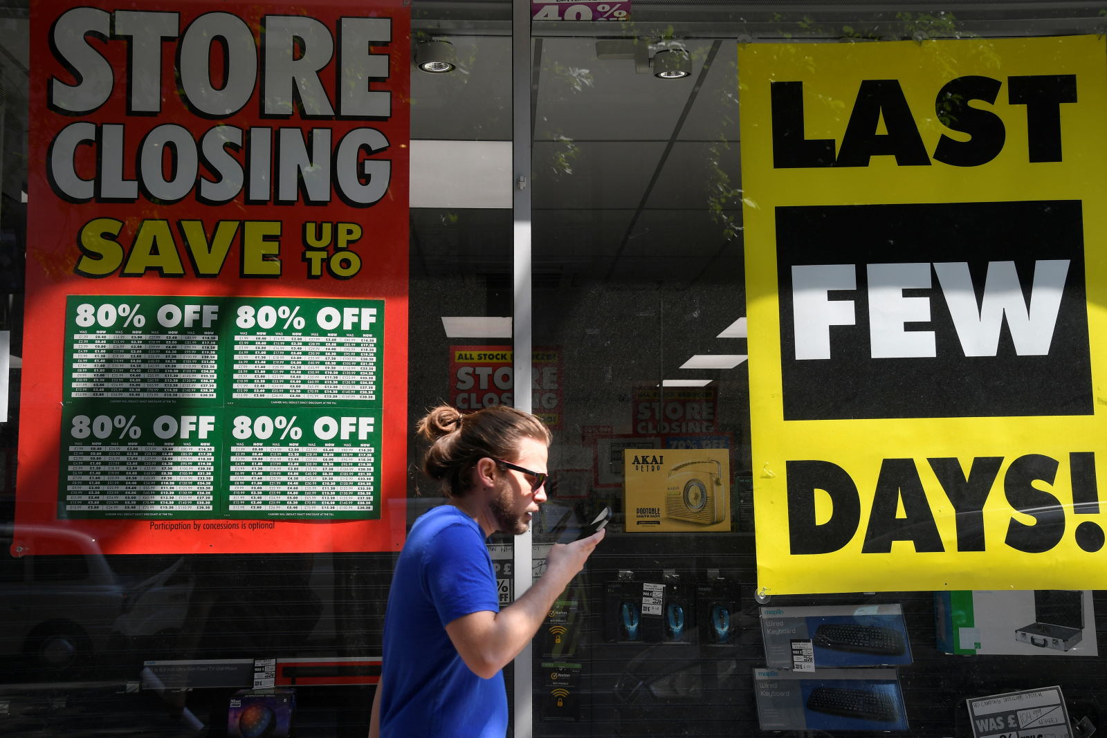 Closing down signs hang in store's window