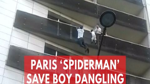 'Spiderman' saves dangling child