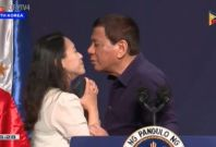 Philippine President Duterte kisses woman