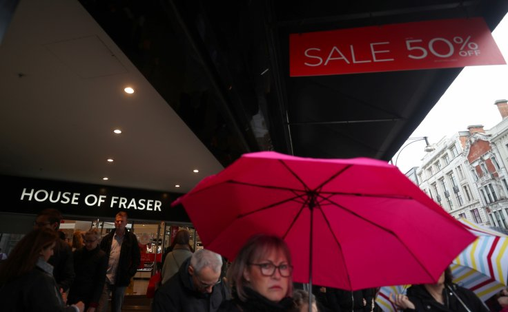 Shoppers walk past House of Fraser