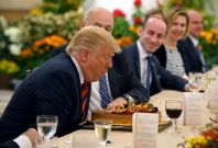 President Donald Trump blows out the candle on his birthday cake