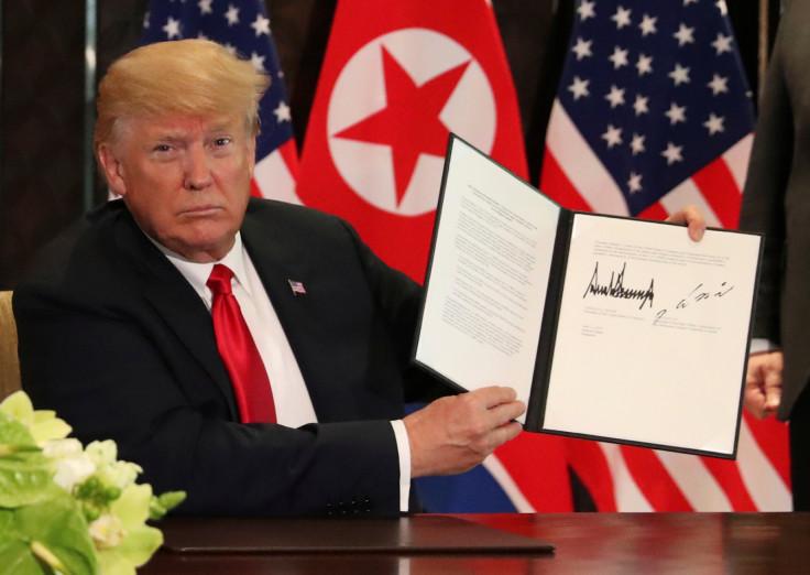 U.S. President Donald Trump shows document