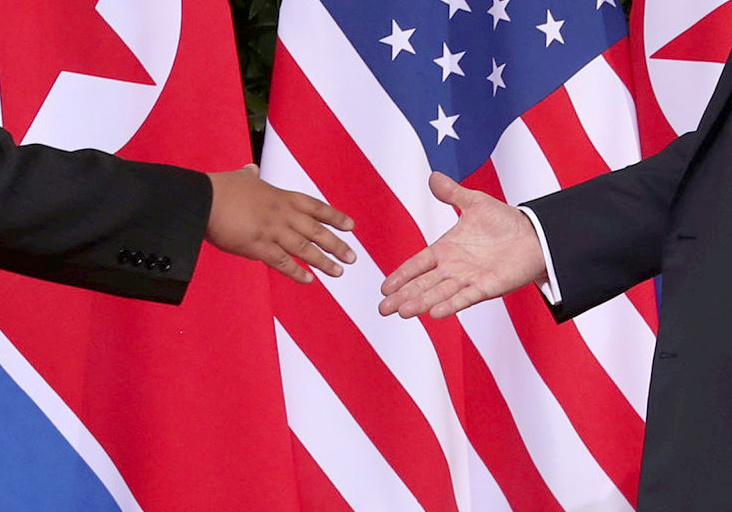 Trump shakes hands with Kim Jong Un