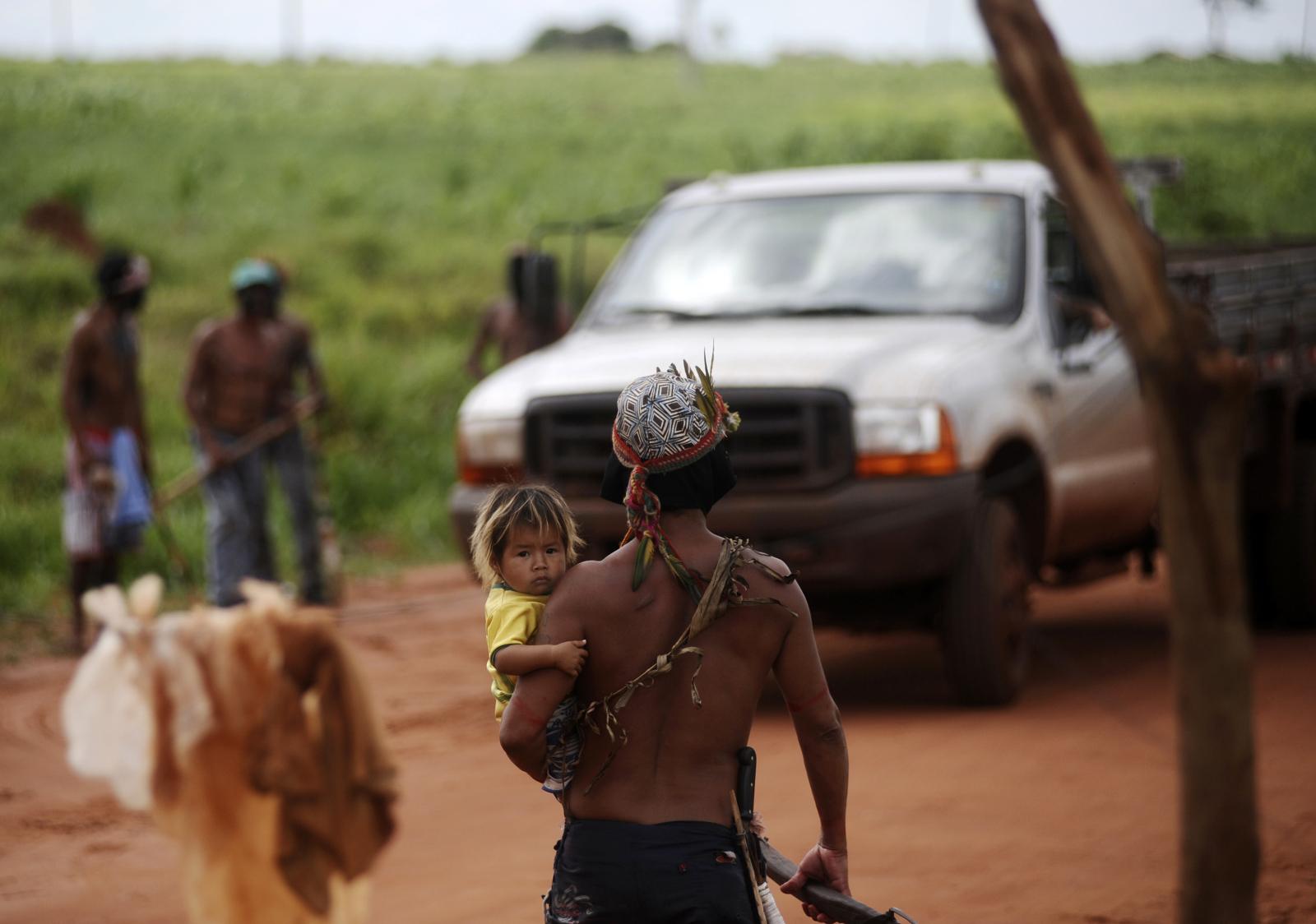 Guarani Nandeva Indians stop a farmer