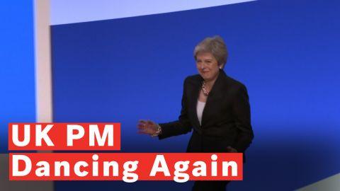 Theresa May dancing