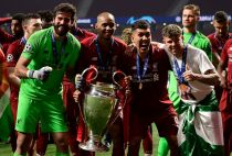 Liverpool with Champions League trophy