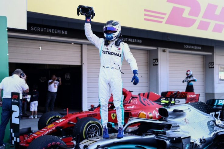 Japanese Grand Prix: Mercedes wins sixth title after Sebastian Vettel botches race start