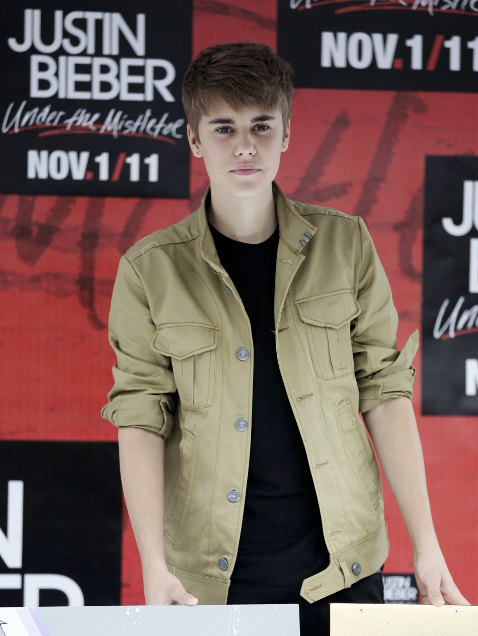"""Canadian pop singer Justin Bieber poses during a photocall at the Foro Sol before his """"My World Tour"""" concert in Mexico City"""