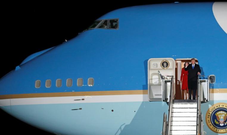 Donald and Melania Trump arrive in London