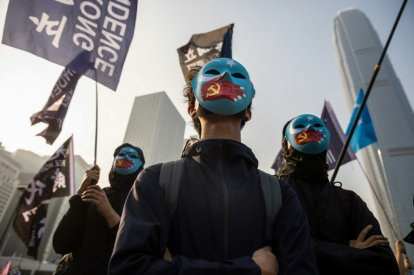Protesters at a rally for China's Uighurs