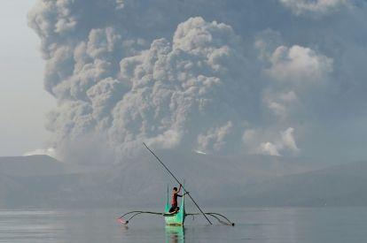 Philippines on alert as volcano spews ash
