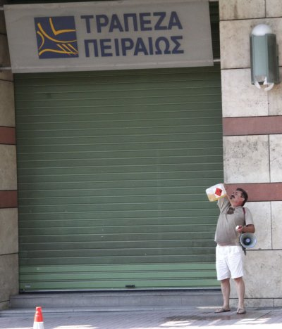A man pours a flammable liquid on his body to set himself on fire outside a Piraeus bank branch in Thessaloniki in northern Greece