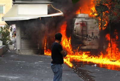 File photo of the kiosk of Dimitris Ptohos burning during riots in Athens