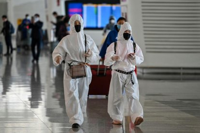 Passengers in protective gear