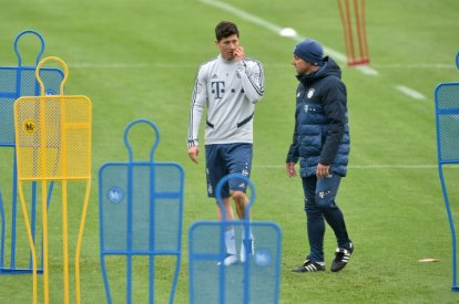 Bayern Munich's headcoach and striker during training