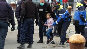 French police with young migrants
