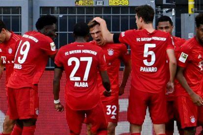 Bayern Munich midfielder Joshua Kimmich (C) celebrates scoring the winning goal at Borussia Dortmund. POOL / Federico GAMBARINI