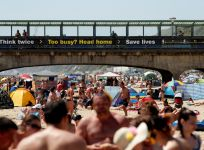 Britons flock beaches and parks