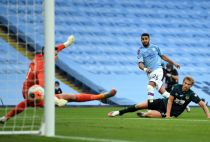 Riyah Mahrez (centre) scores his first goal