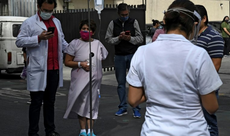 People gather outside a hospital in Mexico