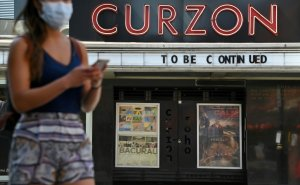 Britain allows cinemas, pubs to reopen