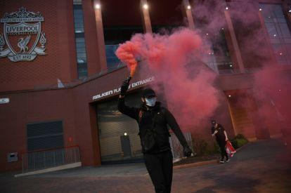 Fans celebrate Liverpool's Premier League title win