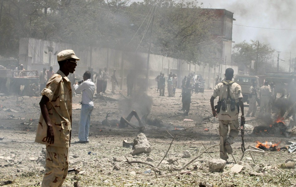 Somalia government soldiers secure the scene of a suicide attack in Somalia's capital Mogadishu