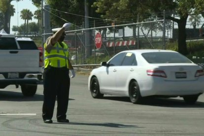 Vehicles move toward LA's Dodger Stadium