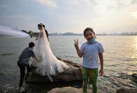 A couple poses for wedding photos