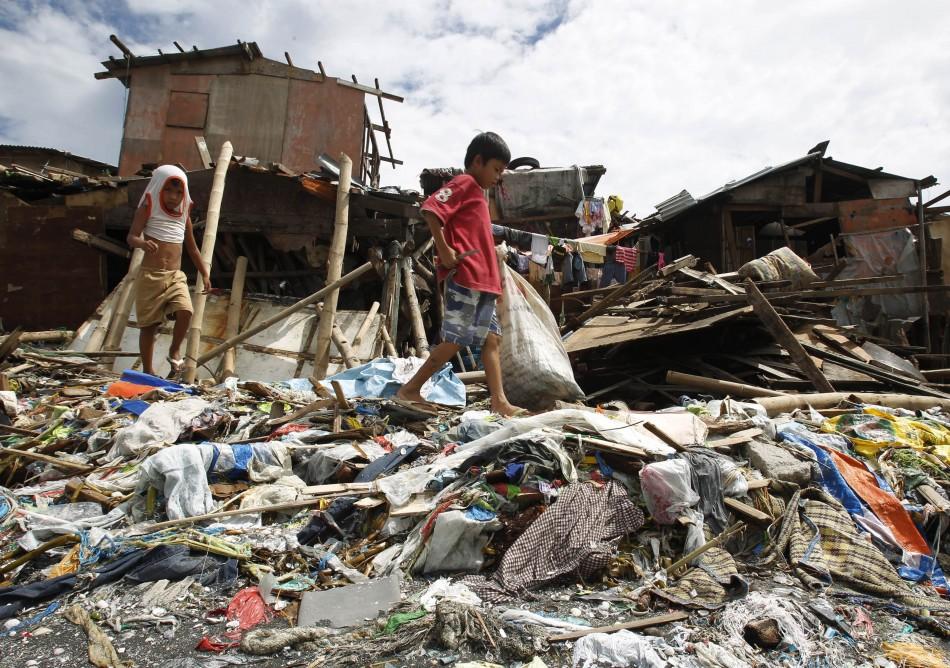 Children Walk Past Shanties