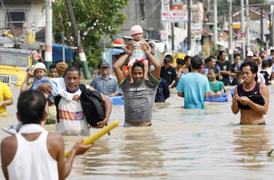Villagers Wade Through Floodwaters After Typhoon Nalgae Hit The Philippines, In Calumpit