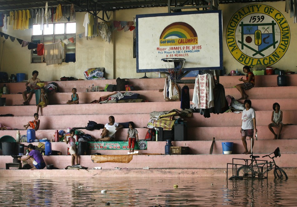 Evacuated Villagers Seek Shelter In A Partially Flooded Basketball Court