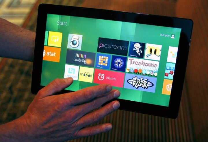 A Reuters reporter runs through a new test Microsoft Windows tablet running a version of its touch-enabled Windows 8, expected to be released in 2012, at the Build conference in Anaheim