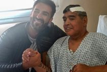 Maradona with his doctor after surgery