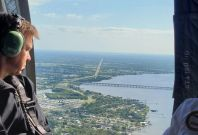 Florida Governor Ron DeSantis conducting a helicopter