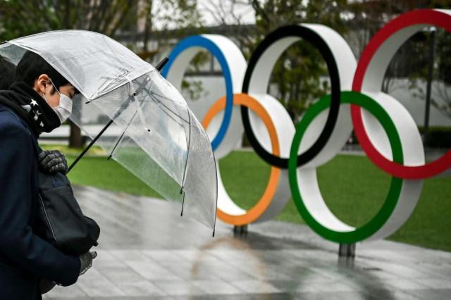 Japan faces new virus emergencies, three months before Olympics