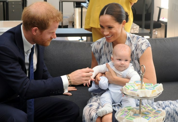 Prince Harry, Archie and Meghan Markle.
