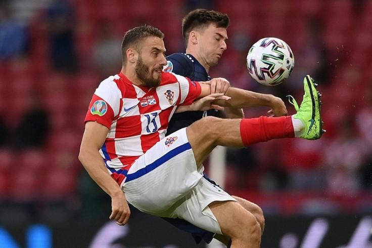 Croatian midfielder Nikola Velasque (left)