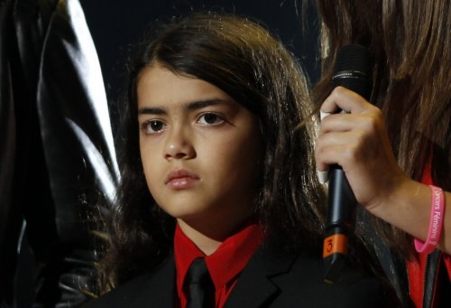 """Prince Michael Jackson II (Blanket), one of late singer Michael Jackson's children reacts on stage during the """"Michael Forever"""" tribute concert, which honours late pop icon Michael Jackson, at the Millennium Stadium in Cardiff, Wales"""