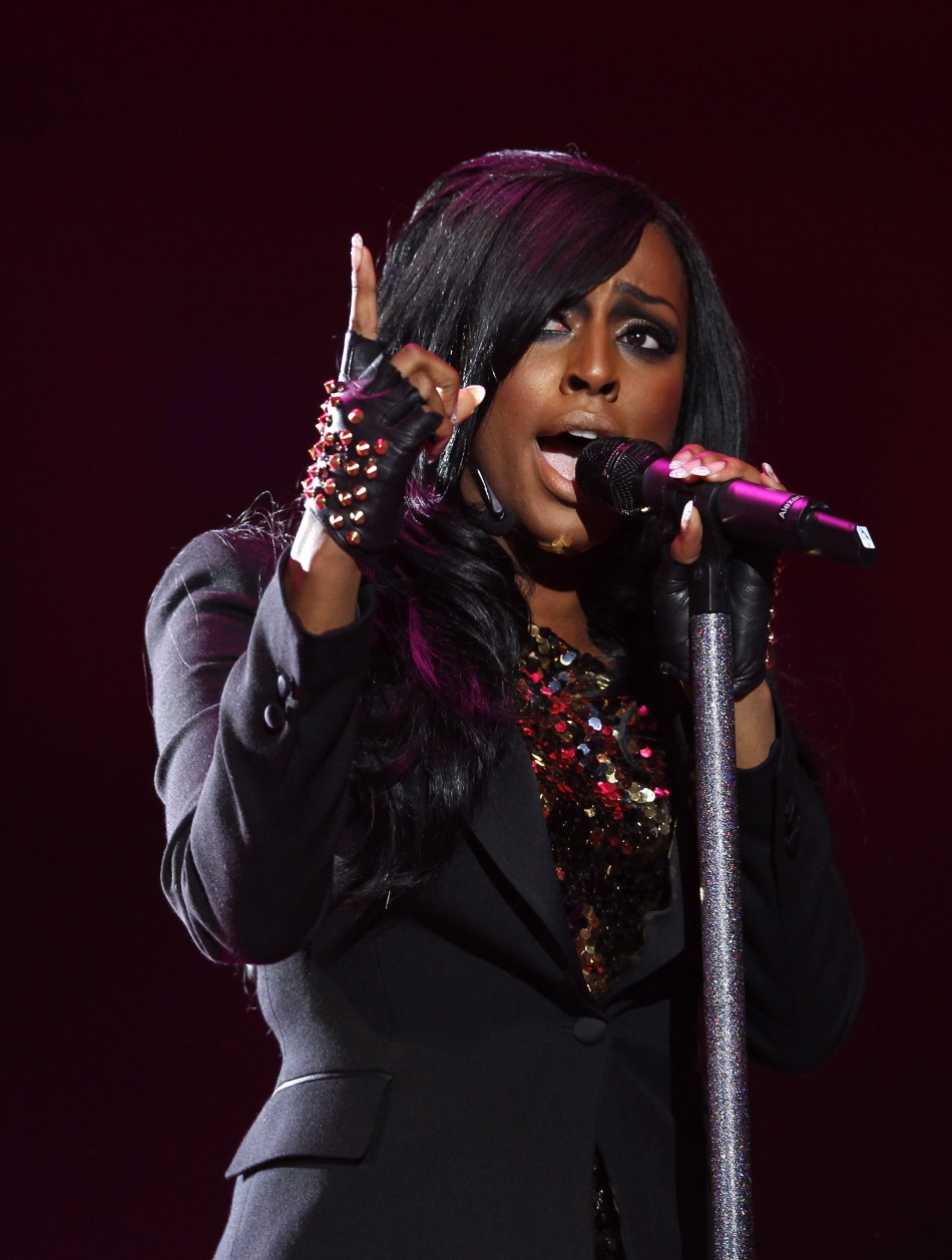 """Alexandra Burke performs during the """"Michael Forever"""" tribute concert, which honours late pop icon Michael Jackson, at the Millennium Stadium in Cardiff, Wales October 8, 2011."""