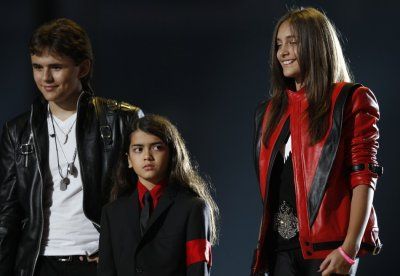 The children of late singer Michael Jackson, Prince Michael Joseph Jackson Jr. and Paris-Michael Katherine Jackson react on stage during the quotMichael Foreverquot tribute concert, which honours their father, at the Millennium Stadium in Cardiff,