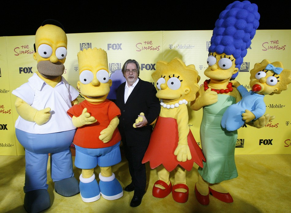 Matt Groening, creator of The Simpsons, poses with characters from show